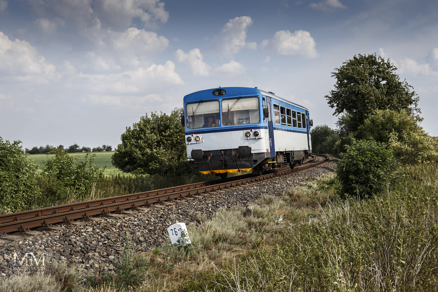 Large format, fine art photograph of small blue and white train. Martin Mojzis.