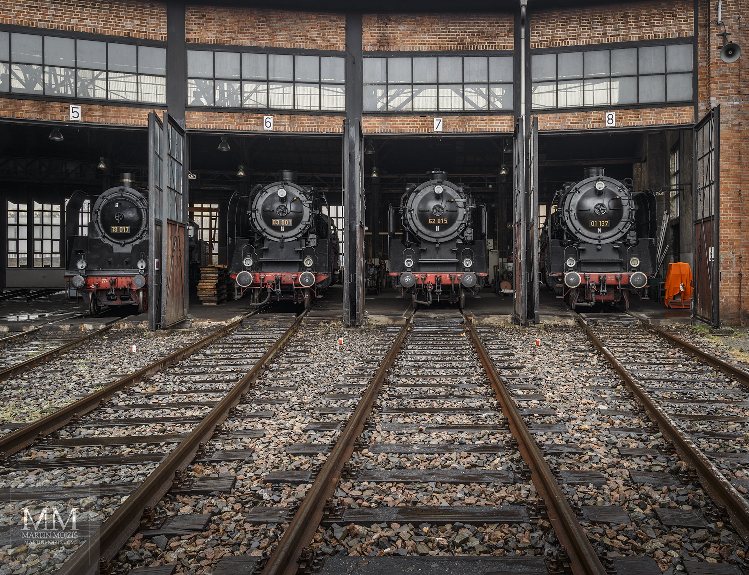 Large format, fine art photograph of steam locomotives in round railway depot close to turntable. Martin Mojzis.