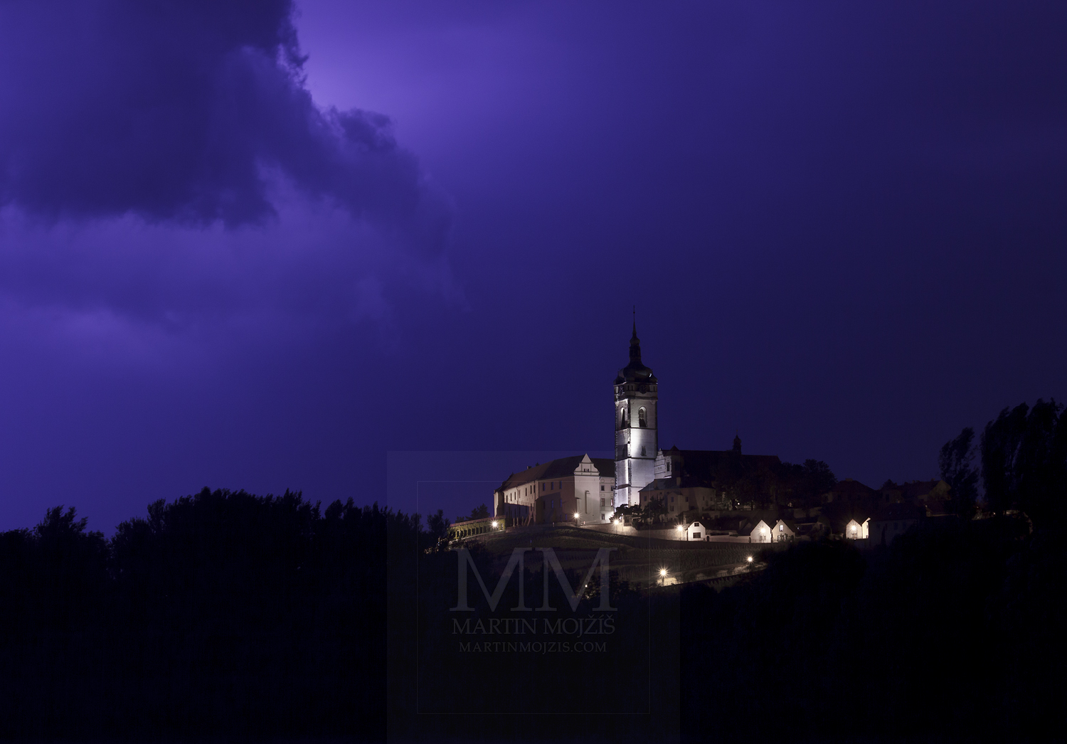 Melnik Chateau and Church in the storm. Photograph © Martin Mojzis.
