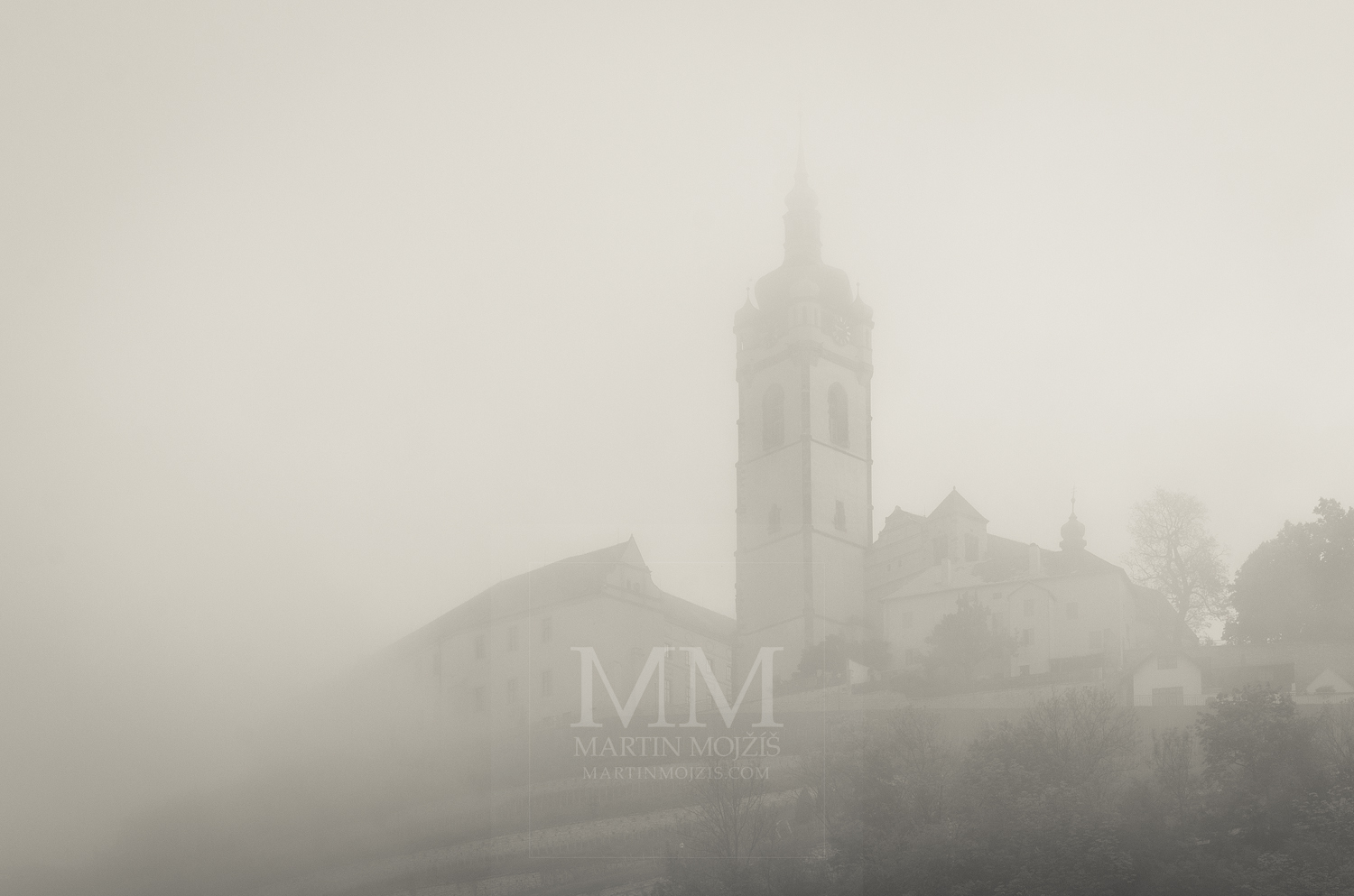 Melnik Chateau and Church in the fog. Photograph © Martin Mojzis.